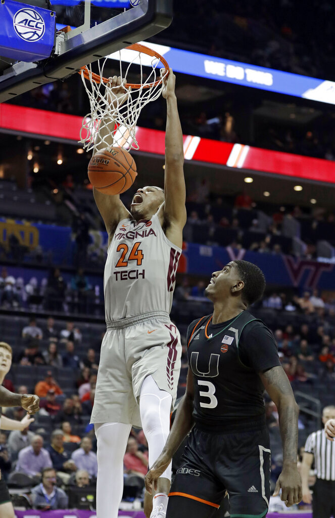 Virginia Tech's Kerry Blackshear Jr. (24) dunks past Miami's Anthony Lawrence II (3) during the second half of an NCAA college basketball game in the Atlantic Coast Conference tournament in Charlotte, N.C., Wednesday, March 13, 2019. (AP Photo/Nell Redmond)