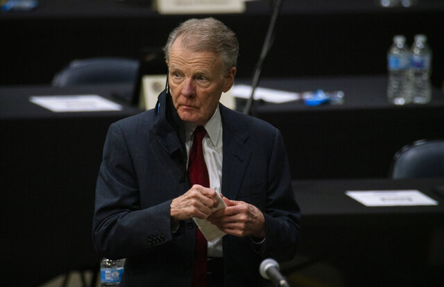 "FILE - In this Jan. 8, 2021, file photo, Illinois House Speaker Michael Madigan appears on the floor as the Illinois House of Representatives convenes at the Bank of Springfield Center, in Springfield, Ill. House Speaker Madigan on Monday, Jan. 11, 2021, said he was ""suspending"" his campaign for a 19th term in the leadership post. Madigan, the longest-serving leader of a legislative body in U.S. history, issued a statement that began, ""This is not a withdrawal."" But it urged House Democrats to ""work to find someone, other than me, to get 60 votes for speaker."" (E. Jason Wambsgans/Chicago Tribune via AP File)"