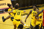 Missouri's Dru Smith, Mark Smith, Kobe Brown and Xavier Pinson, form left, celebrate after Missouri defeated Illinois 81-78 in an NCAA college basketball game Saturday, Dec. 12, 2020, in Columbia, Mo. (AP Photo/L.G. Patterson)