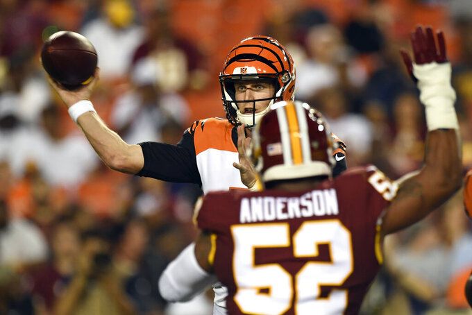 Cincinnati Bengals quarterback Ryan Finley throws a pass as Washington Redskins linebacker Ryan Anderson (52) defends during the first quarter of an NFL preseason football game in Landover, Md., Thursday, Aug. 15, 2019. (AP Photo/Susan Walsh)