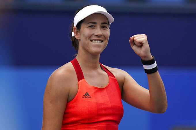 Garbine Muguruza, of Spain, reacts after defeating Qiang Wang, of China, during the second round of the tennis competition at the 2020 Summer Olympics, Monday, July 26, 2021, in Tokyo, Japan. (AP Photo/Seth Wenig)