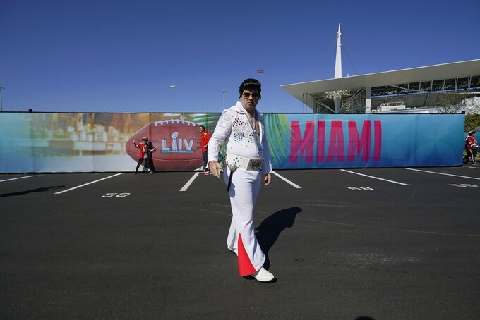An Elvis impersonator arrives for the NFL Super Bowl 54 football game between the San Francisco 49ers and the Kansas City Chiefs Sunday, Feb. 2, 2020, in Miami. (AP Photo/David J. Phillip)