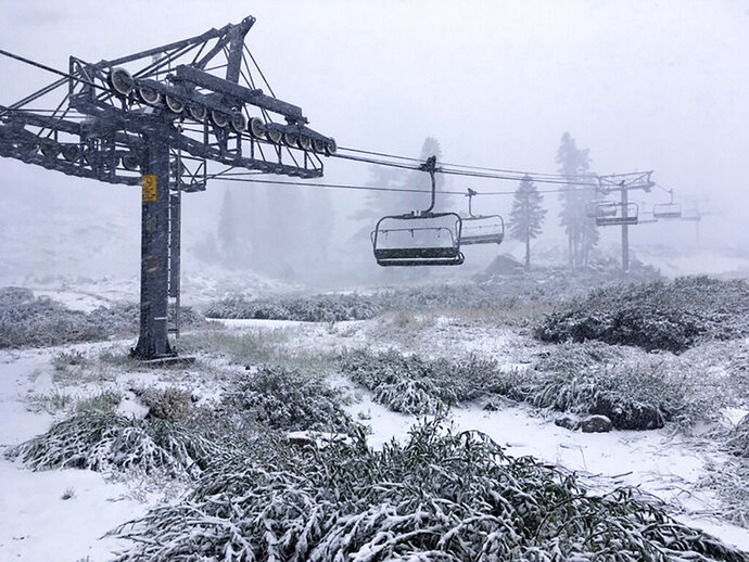 This photo provided by Squaw Valley Alpine Meadows shows a fresh dusting of snow at the Squaw Valley Alpine Ski resort on Monday, Sept. 16, 2019. A strong cold front packing winds gusting up to 50 mph (80 kph) dropped the first snow of the season on the top of the Sierra Monday. (Marcus Morgan/ Squaw Valley Alpine Meadows via AP)