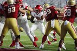 Louisville running back Jalen Mitchell (15) runs for a touchdown during the first half of an NCAA college football game against Boston College, Saturday, Nov. 28, 2020, in Boston. (AP Photo/Michael Dwyer)