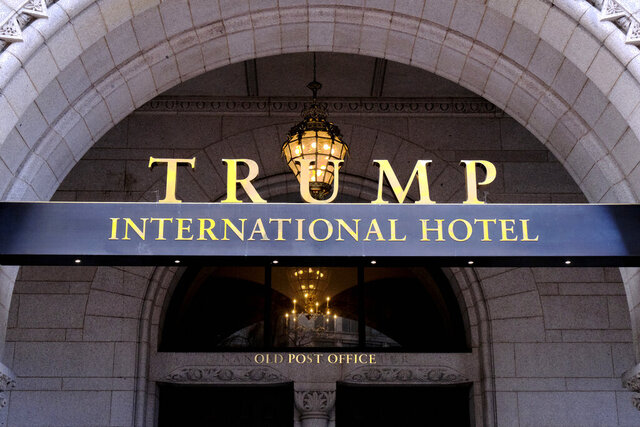 FILE - This March 11, 2019 file photo, shows the north entrance of the Trump International in Washington. Financial records related to President Donald Trump's Washington hotel can be kept on hold, a federal appeals court said Thursday, July 9, 2020, while Trump asks the U.S. Supreme Court to hear an appeal in a lawsuit that accuses him of illegally profiting off the presidency. (AP Photo/Mark Tenally, File)