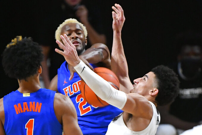 Vanderbilt guard Scotty Pippen Jr., right, has a shot blocked by Florida guard Scottie Lewis during the second half of an NCAA college basketball game Wednesday, Dec. 30, 2020, in Nashville, Tenn. (AP Photo/John Amis)