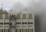 People are rescued from a nine-story building with offices of a state-run telephone company during a fire in Mumbai, India, Monday, July 22, 2019. (AP Photo/Rafiq Maqbool)