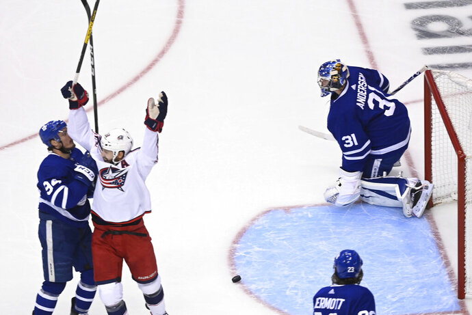 Columbus Blue Jackets center Boone Jenner (38) celebrates a Blue Jackets goal against Toronto Maple Leafs goaltender Frederik Andersen (31) during the first period of an NHL hockey playoff game Sunday, Aug. 9, 2020, in Toronto. (Nathan Denette/The Canadian Press via AP)