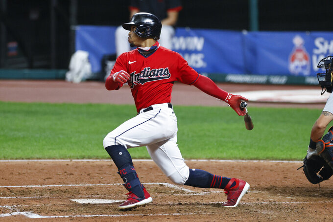 FILE - Cleveland Indians' Francisco Lindor singles off Detroit Tigers starting pitcher Matthew Boyd during the sixth inning of a baseball game, Saturday, Aug. 22, 2020, in Cleveland. The Cleveland Indians have agreed to trade four-time All-Star shortstop Francisco Lindor and pitcher Carlos Carrasco to the New York Mets, a person with direct knowledge of the deal told the Associated Press on Thursday, Jan. 7, 2021. (AP Photo/Ron Schwane, File)