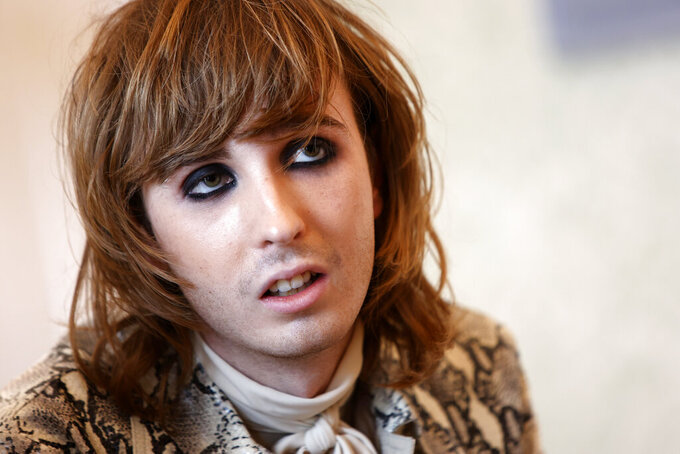 Thomas Raggi, guitarist of Italian band Maneskin, winners of the Eurovision Song Contest in May, speaks during an interview with the Associated Press at a hotel in Rome, Tuesday, July 27, 2021. (AP Photo/Riccardo De Luca)