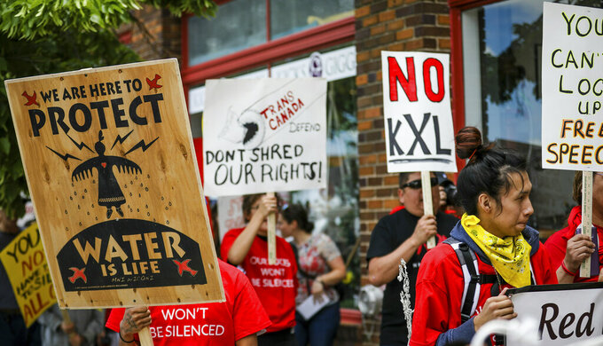 FILE - In this Jun 12, 2019, file photo, walking up Main Street the procession protesting against the Keystone XL pipeline makes its way to Andrew W. Bogue Federal Courthouse in Rapid City, S.D.  The sponsor of the Keystone XL crude oil pipeline says it's pulling the plug on the contentious project, Wednesday, June 9, 2021,  after Canadian officials failed to persuade the Biden administration to reverse its cancellation of the company's permit.(Adam Fondren/Rapid City Journal via AP)