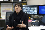 In this Monday May 13, 2019 photo Juliet Fine, principal at Beverly Hills Unified School District's K-8 Horace Mann School talks about school security during an interview in her office in Beverly Hills, Calif. Schools in Beverly Hills and others nationwide are adopting a strategy that aims to speed up the law enforcement response to shootings. Beverly Hills officials have added armed security guards, surveillance cameras and an app to report attacks and connect with police. (AP Photo/Richard Vogel)