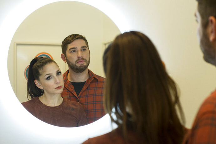 This image released by Sundance Now shows Shoshannah Stern, left, and Josh Feldman in a scene from