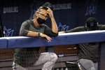 FILE - In this Sunday, July 12, 2020, file photo, Miami Marlins manager Don Mattingly watches a baseball scrimmage at Marlins Park in Miami. The Marlins, one of the most under-the-radar teams in sports, have making news lately, all of it bad. Overtaken by a coronavirus outbreak, the team must scramble for roster replacements as they try salvage a season barely underway. (AP Photo/Lynne Sladky, File)
