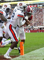Alabama quarterback Tua Tagovailoa (13) pushes Auburn defensive back Jamel Dean (12) past the pylon for the game's first touchdown during the first half of an NCAA college football game, Saturday, Nov. 24, 2018, in Tuscaloosa, Ala. (AP Photo/Vasha Hunt)