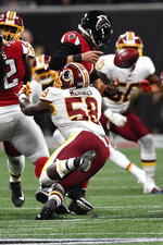 Washington Redskins linebacker Cassanova McKinzy (58) causes a fumble on Atlanta Falcons quarterback Danny Etling (1)during the second half an NFL preseason football game, Thursday, Aug. 22, 2019, in Atlanta. (AP Photo/Mike Stewart)
