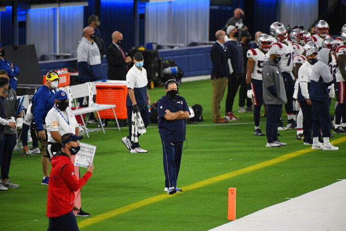 New England Patriots head coach Bill Belichick, center, looks on in the first half of an NFL football game against the Los Angeles Rams in Inglewood, Calif., Thursday, Dec. 10, 2020. (Keith Birmingham/The Orange County Register via AP)