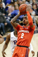 Clemson's Marcquise Reed (2) shoots in front of Pittsburgh's Xavier Johnson during the second half of an NCAA college basketball game, Wednesday, Feb. 27, 2019, in Pittsburgh. (AP Photo/Keith Srakocic)