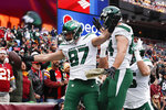 New York Jets tight end Daniel Brown (87) celebrates his touchdown with teammate tight end Ryan Griffin (84) in the first half of an NFL football game against Washington Redskins, Sunday, Nov. 17, 2019, in Landover, Md. (AP Photo/Alex Brandon)