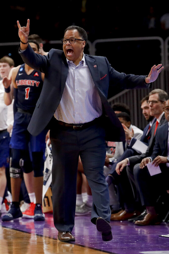 Liberty coach Ritchie MaKay yells during the first half of the team's second-round game against Virginia Tech in the NCAA men's college basketball tournament Sunday, March 24, 2019, in San Jose, Calif. (AP Photo/Jeff Chiu)