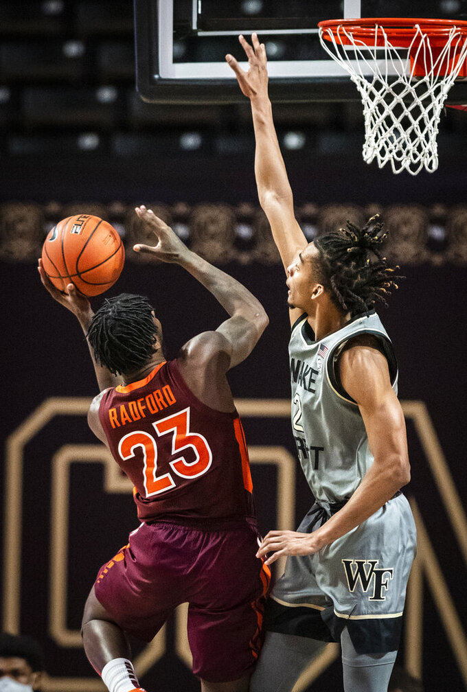 Virginia Tech guard Tyrece Radford (23) shoots under defense from Wake Forest guard Jalen Johnson (2) during an NCAA college basketball game Sunday, Jan. 17, 2021, in Winston-Salem, N.C. (Andrew Dye/The Winston-Salem Journal via AP)