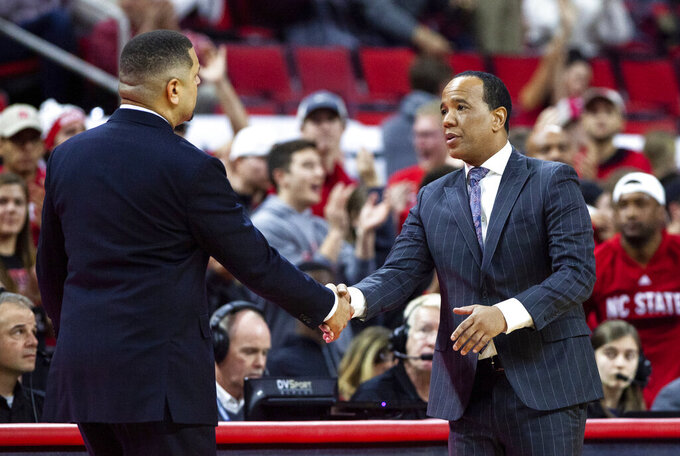 North Carolina State coach Kevin Keatts, right, shakes hands with Pittsburgh coach Jeff Capel, left, after an NCAA college basketball game in Raleigh, N.C., Saturday, Jan. 12, 2019. (AP Photo/Ben McKeown)
