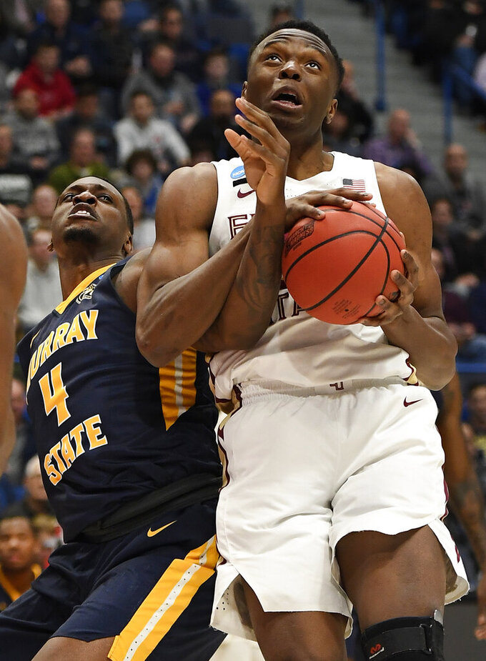 Florida State's Mfiondu Kabengele (25) tangles with Murray State's Brion Sanchious (4) as he pulls down a rebound during the first half of a second round men's college basketball game in the NCAA tournament, Saturday, March 23, 2019, in Hartford, Conn. (AP Photo/Jessica Hill)