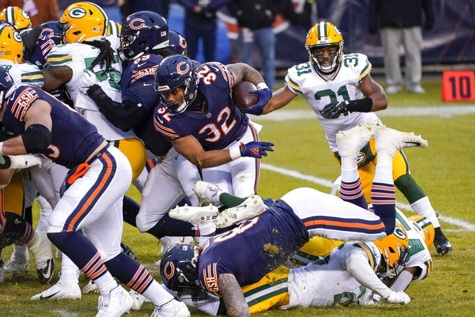 Chicago Bears' David Montgomery runs for a touchdown during the first half of an NFL football game against the Green Bay Packers Sunday, Jan. 3, 2021, in Chicago. (AP Photo/Nam Y. Huh)