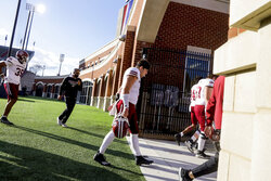 Massachusetts quarterback Garrett Dzuro (9) walks off the field following their loss in an NCAA college football game against Liberty on Friday, Nov. 27, 2020, at Williams Stadium in Lynchburg, Va. (AP Photo/Shaban Athuman)