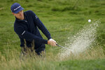 Justin Rose, of England, hits out of the bunker on the 17th hole during the second round of the U.S. Open Championship golf tournament Friday, June 14, 2019, in Pebble Beach, Calif. (AP Photo/Marcio Jose Sanchez)