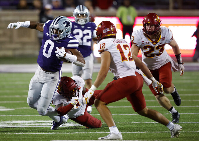Kansas State tight end Daniel Imatorbhebhe (0) is tackled by Iowa State defensive back Isheem Young (1) as defensive back Greg Eisworth II (12) and linebacker Mike Rose (23) also defend during the fourth quarter of an NCAA college football game Saturday, Oct. 16, 2021, in Manhattan, Kan. (AP Photo/Colin E. Braley)