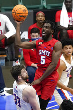 SMU guard Emmanuel Bandoumel (5) shoots over Boise State forward Mladen Armus (33) during the second half of an NCAA college basketball game in the first round of the NIT, Thursday, March 18, 2021, in Frisco, Texas. (AP Photo/Tony Gutierrez)
