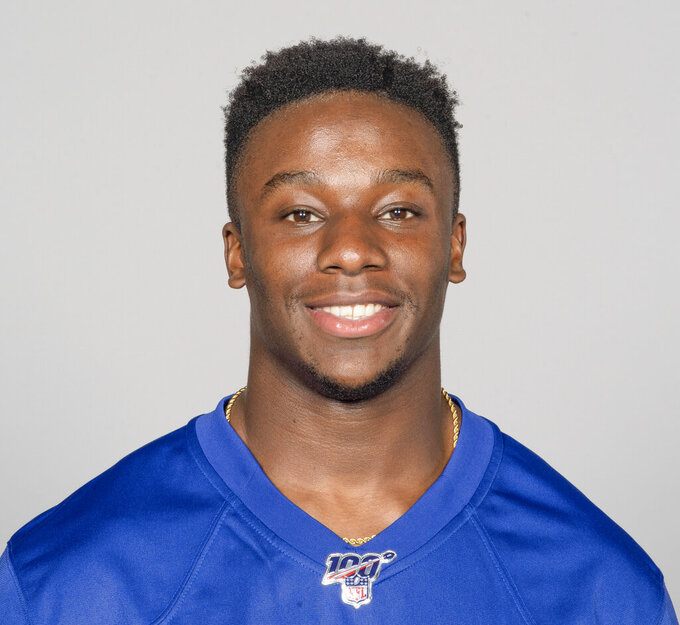 Man charged in shooting of Giants draft pick and teammate