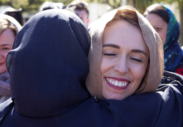FILE - In this Sept. 24, 2020, file photo, New Zealand Prime Minister Jacinda Ardern is embraced as she arrives at the Al Noor mosque in Christchurch, New Zealand. Opinion polls indicate Ardern is on track to win a second term as prime minister in an election on Saturday, Oct. 17, 2020. (AP Photo/Mark Baker) (AP Photo/Mark Baker)
