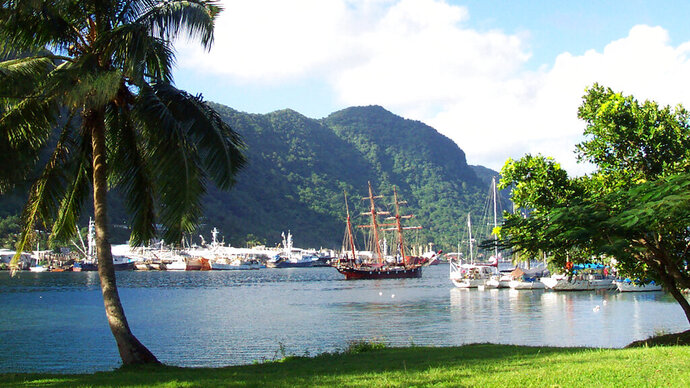 FILE - This July 2002 file photo shows a sailing ship in the harbor at Pago Pago, American Samoa. Many residents of American Samoa are concerned that a federal judge's recent ruling in Utah, saying those born in the U.S. territory should be recognized as U.S. citizens, could threaten