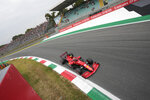 Ferrari driver Carlos Sainz of Spain steers his car during qualifying session at the Monza racetrack, in Monza, Italy , Friday, Sept.10, 2021. The Formula one race will be held on Sunday. (AP Photo/Luca Bruno)