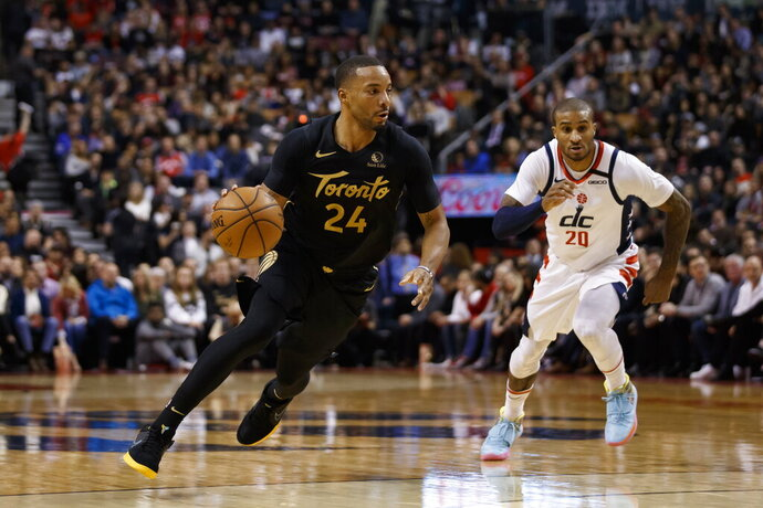 Toronto Raptors guard Norman Powell (24) drives as Washington Wizards guard Gary Payton II (20) defends during the first half of an NBA basketball game Friday, Jan. 17, 2020, in Toronto. (Cole Burston/The Canadian Press via AP)
