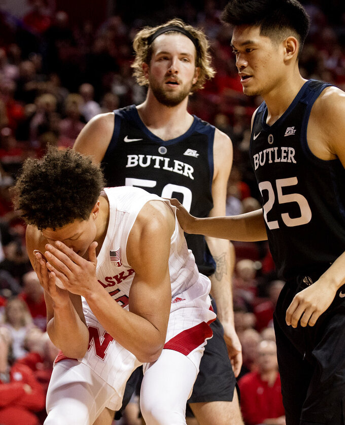 Nebraska forward Isaiah Roby (15) reacts after losing the ball, next to Butler's Joey Brunk (50) and Christian David (25) during the first half of an NCAA college basketball game in the NIT on Wednesday, March 20, 2019, in Lincoln, Neb. (Francis Gardler/Lincoln Journal Star via AP)