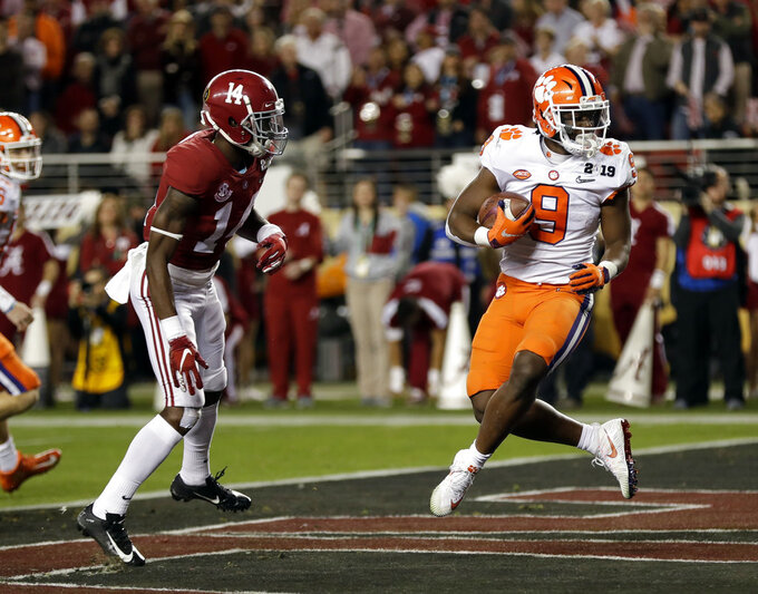 Clemson's Travis Etienne runs for a touchdown during the first half the NCAA college football playoff championship game against Alabama, Monday, Jan. 7, 2019, in Santa Clara, Calif. (AP Photo/David J. Phillip)