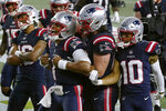 New England Patriots quarterback Cam Newton, center, celebrates his rushing touchdown with teammates in the second half of an NFL football game against the Baltimore Ravens, Sunday, Nov. 15, 2020, in Foxborough, Mass. (AP Photo/Charles Krupa)
