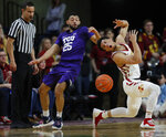 TCU guard Alex Robinson, left, pokes the ball away from Iowa State guard Lindell Wigginton, right, during the first half of an NCAA college basketball game, Saturday, Feb. 9, 2019, in Ames. (AP Photo/Matthew Putney)