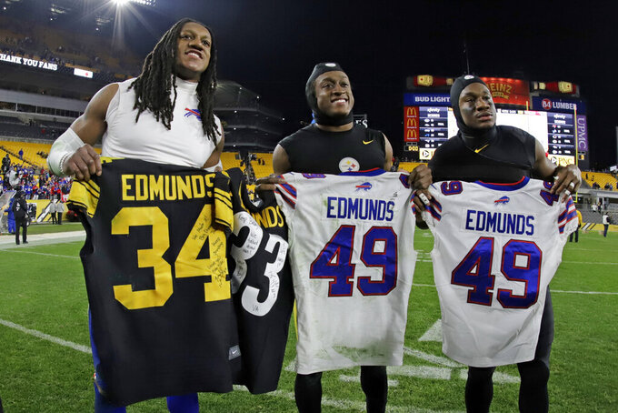 Buffalo Bills middle linebacker Tremaine Edmunds, left, swaps his jersey with his brothers Pittsburgh Steelers strong safety Terrell Edmunds, center, and Pittsburgh Steelers running back Trey Edmunds, right, following an NFL football game in Pittsburgh, Sunday, Dec. 15, 2019. The Bills won 17-10. (AP Photo/Gene J. Puskar)