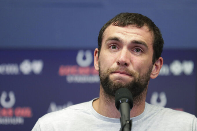 FILE - In this Saturday, Aug. 24, 2019, file photo, Indianapolis Colts quarterback Andrew Luck speaks during a news conference following the team's NFL preseason football game against the Chicago Bears, in Indianapolis. The Colts launch into the post-Luck era with his successor on the bench. Coach Frank Reich plans to sit Jacoby Brissett against the Bengals on Thursday night, the Colts' first game since Andrew Luck announced his retirement. Either Phillip Walker or Chad Kelly will start, competing for the No. 2 job. (AP Photo/Michael Conroy, File)