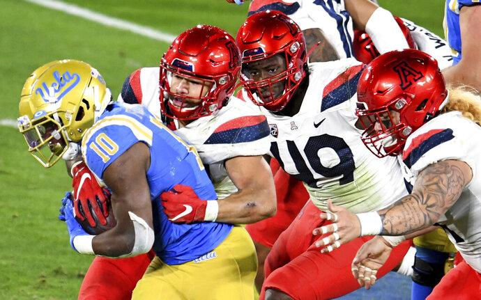UCLA running back Demetric Felton carries against Arizona during the first half of an NCAA college football game Saturday, Nov. 28, 2020, in Pasadena, Calif. (Keith Birmingham/The Orange County Register via AP)