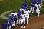 The Chicago Cubs celebrate after beating the Milwaukee Brewers during a baseball game in Chicago, on Thursday, Aug. 13, 2020. The Cubs won the game 4-2. (AP Photo/Jeff Haynes)