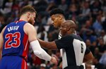 Referee Tony Brown (6) keeps Detroit Pistons forward Blake Griffin (23) and Milwaukee Bucks forward Giannis Antetokounmpo apart during the first half of Game 4 of a first-round NBA basketball playoff series, Monday, April 22, 2019, in Detroit. (AP Photo/Carlos Osorio)