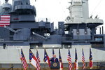 With the USS Battleship North Carolina in the background, President Donald Trump speaks during an event to designate Wilmington as the first American World War II Heritage City, Wednesday, Sept. 2, 2020, in Wilmington, N.C. (AP Photo/Evan Vucci)