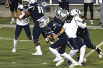Nevada quarterback Carson Strong (12) during the first half of the team's NCAA college football game against Utah State on Thursday, Nov. 5, 2020, in Reno, Nev. (AP Photo/Lance Iversen)