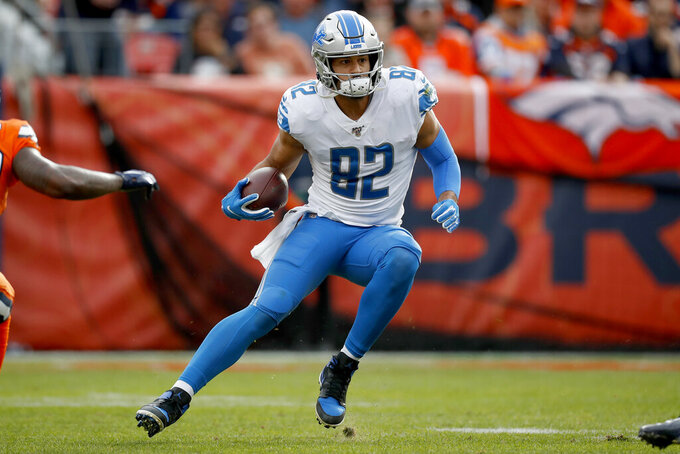 Detroit Lions tight end Logan Thomas (82) runs a play against the Denver Broncos during the first half of an NFL football game, Sunday, Dec. 22, 2019, in Denver. (AP Photo/David Zalubowski)