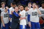 Duke guard Tre Jones (3) embraces coach Mike Krzyzewski after Duke defeated Georgetown 81-73 in an NCAA college basketball game in the 2K Empire Classic, Friday, Nov. 22, 2019 in New York. (AP Photo/Kathy Willens)